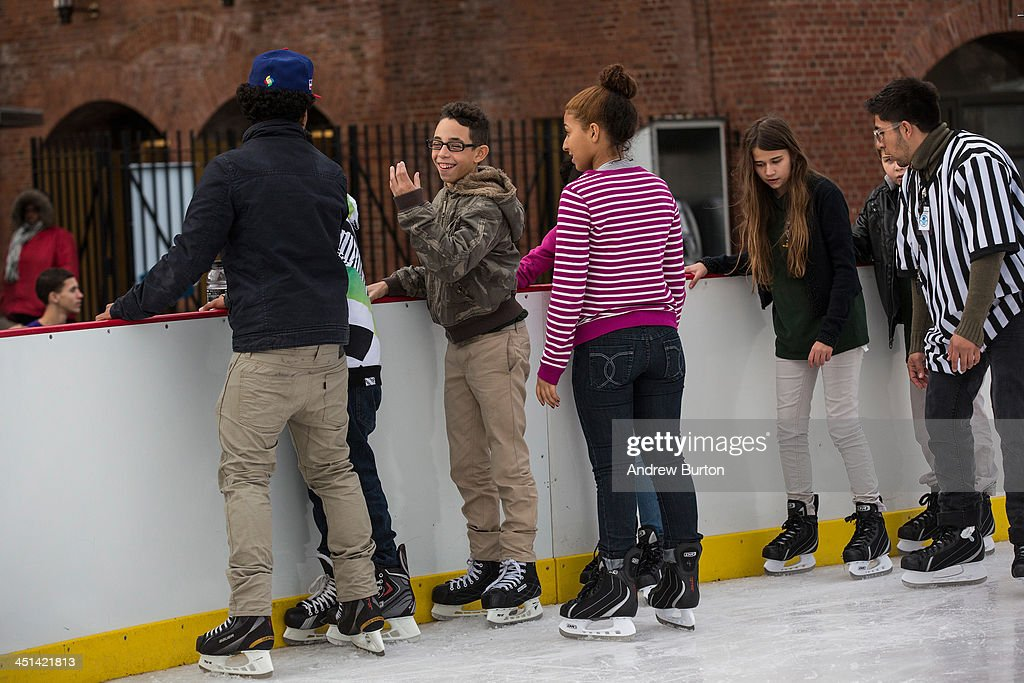 Kids ice skate at the ice rink at McCarren Pool, which opened for the winter months last week, on November 22, 2013 in the Green Point neighborhood of the Brooklyn borough of New York City. McCarren Pool originally opened in 1936, though it closed in 1984; it reopened in 2012 after a multimillion dollar remodeling. The winter ice rink was unable to open last winter due to complications; this year it is scheduled to stay open through January 5th, 2014.