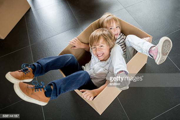 Kids in a box while moving house