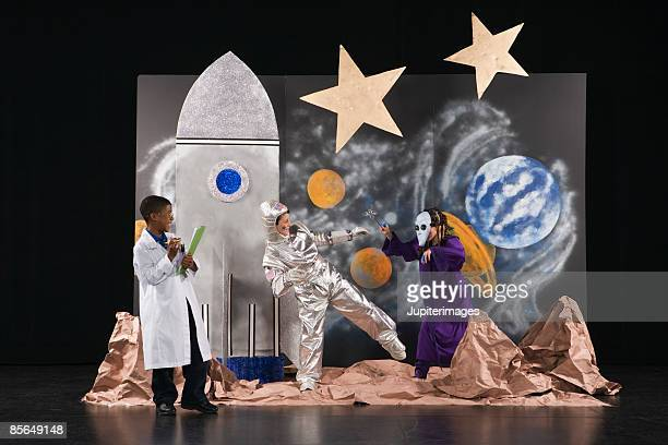 Kids in costume acting on stage