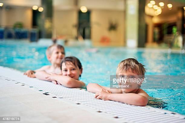 Kids in indoors swimming pool