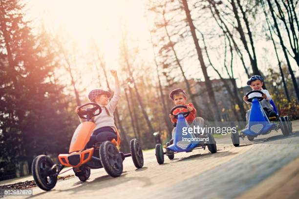 Kids in small cars racing n the park