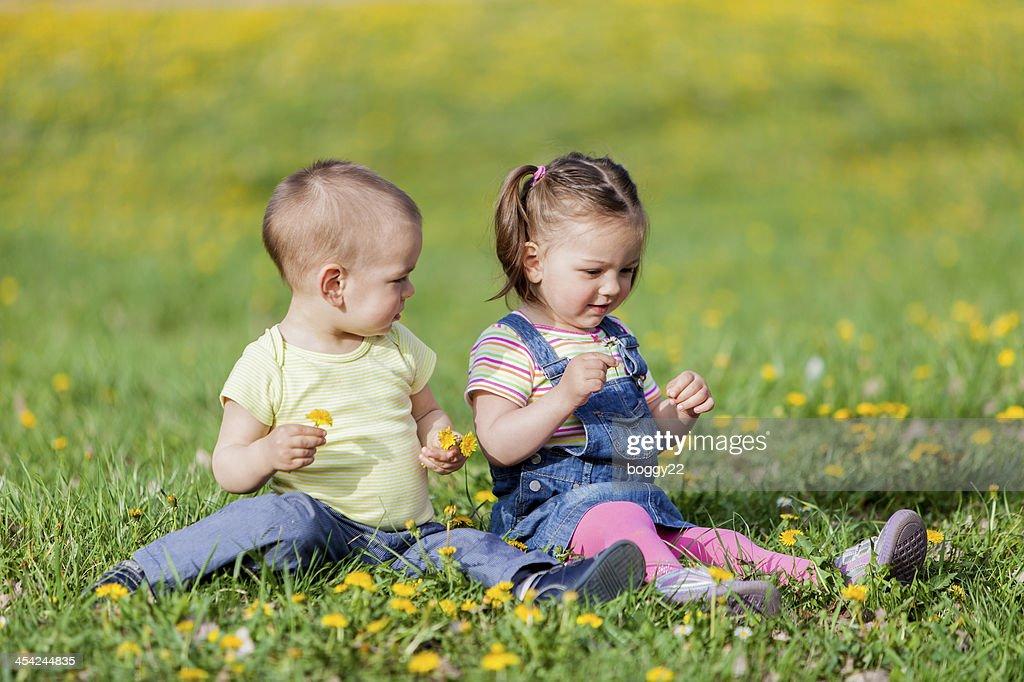 Kids in the spring field : Stock Photo