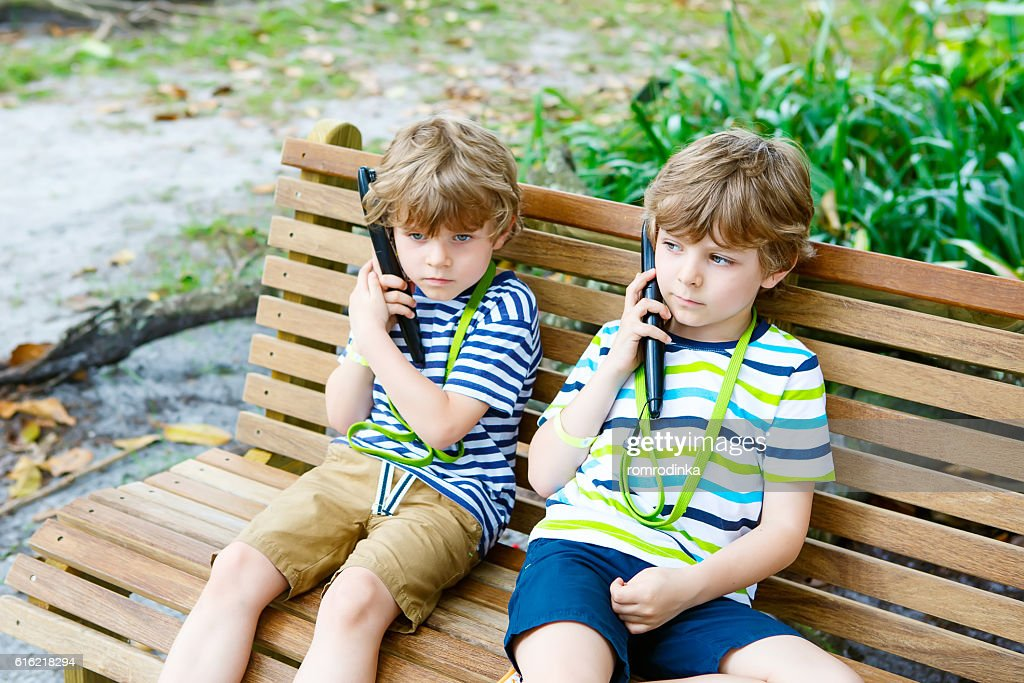 Kids listening to audio guide on excursion : Stock Photo