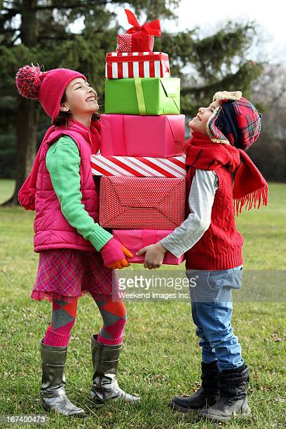 Kids looking on a little gift