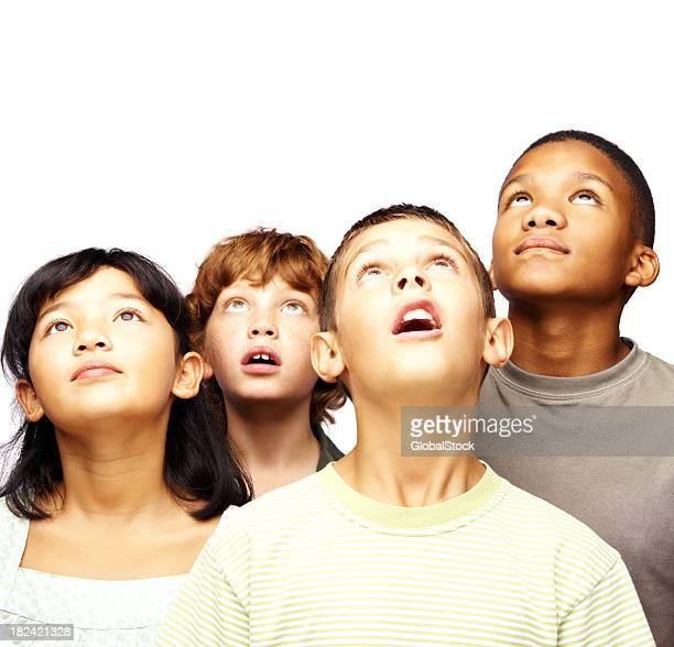 Kids looking up at copyspace