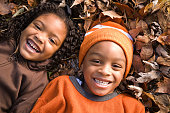 Kids lying on leaves