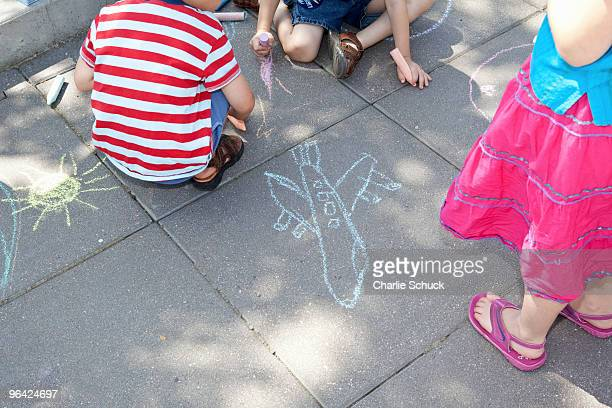 kids making chalk drawings