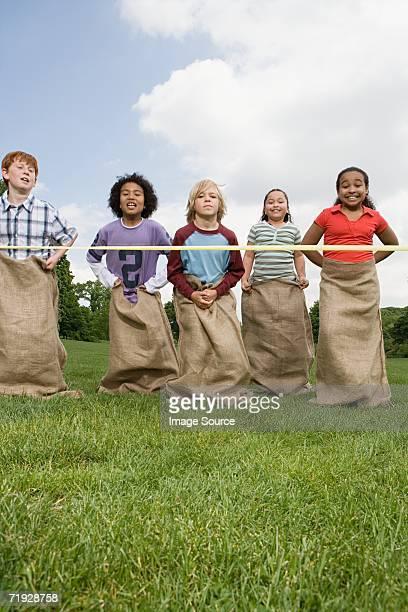 Kids near finish line in sack race
