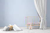 Kids room interior, with bed, lots of decoration, pillows, toys. Pastel colors. Daylight scene. copy space background for designers