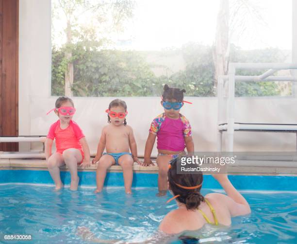Kids on a lesson of swimming.