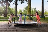 kids on carousal in playground