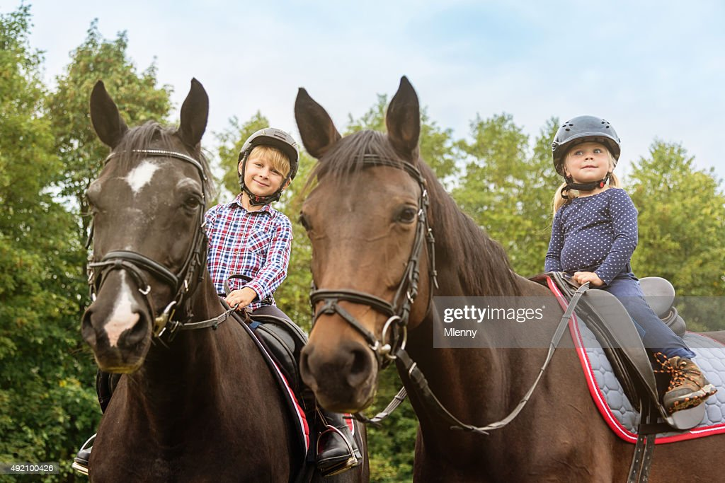 Kids on Horses Brother and Sister Horseback Riding : Stock Photo