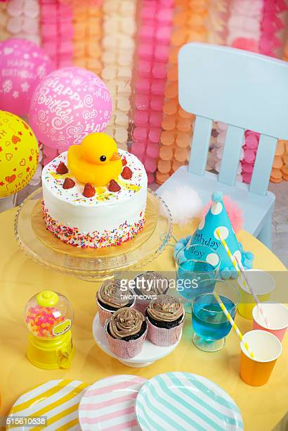 Kids or children birthday cake party table top shot.