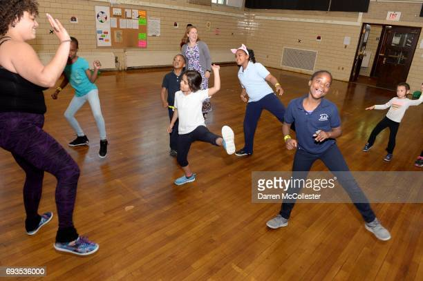 Kids participate in a Zumba class during the Kohl's and Boston Children's Hospital Healthy Family Fun Donation Event at Chittick Elementary School...