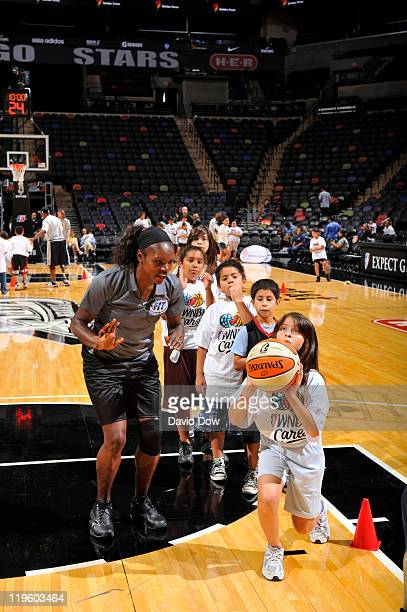Kids participates with Marie FerdinandHarris of the Phoenix Mercury during the Jamba juice WNBA Fit Clinic as part of the 2011 WNBA Cares Community...