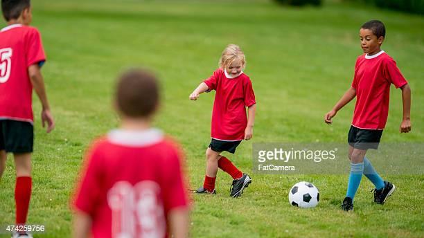 Kids Passing a Soccer Ball