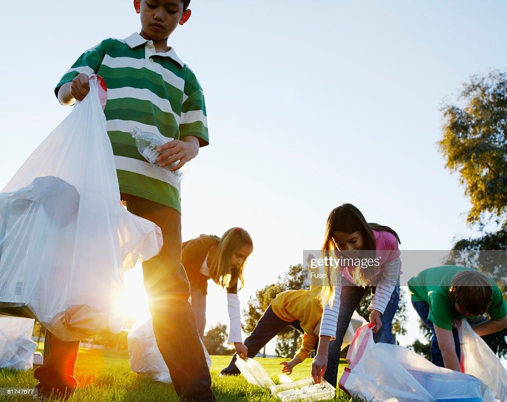 Kids Picking Up Trash in Field