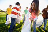 Kids Picking Up Trash in Field