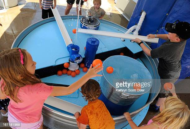 Kids place the plastic balls in the Whirlpools and Fountains exhibit and watch them get sucked down one hole and shoot out another The Children's...