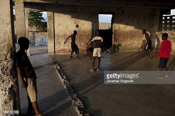 Kids play at a building that was used as a prison when Duvalier was president It is now used as a makeshift school and a playground for kids February...