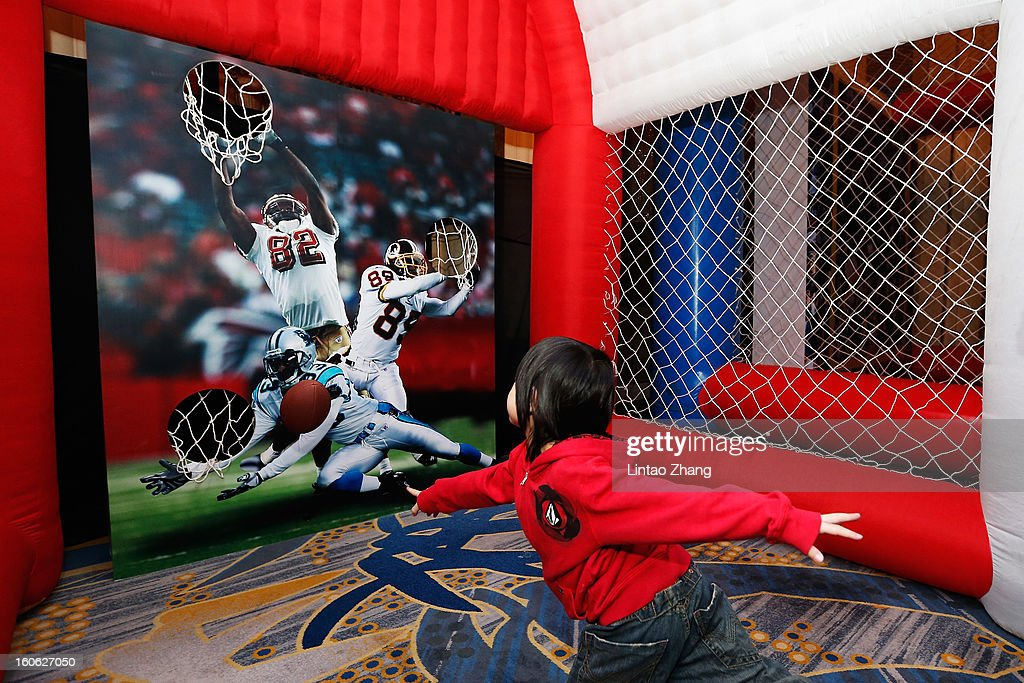 Kids play ball during the official NFL China Super Bowl Party at Kerry Hotel on February 4, 2013 in Beijing, China.