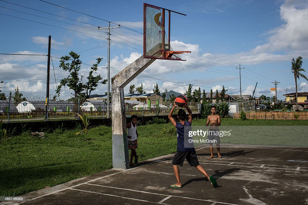 Kids play basketball on April 19, 2014 in Sante Fe, Leyte, Philippines. Basketball is the most popular sport in the Philippines. In the aftermath of Superstorm Yolanda that struck the coast on November 8, 2013 leaving more than 6000 dead and many more homeless, basketball hoops were some of the first things to be repaired and rebuilt amongst the rubble, showing the Filipino's resilience and intense love for the sport. Five months after the storm, basketball courts have re-emerged in large numbers across the damaged provinces using any available space and many being rebuilt from storm debris.