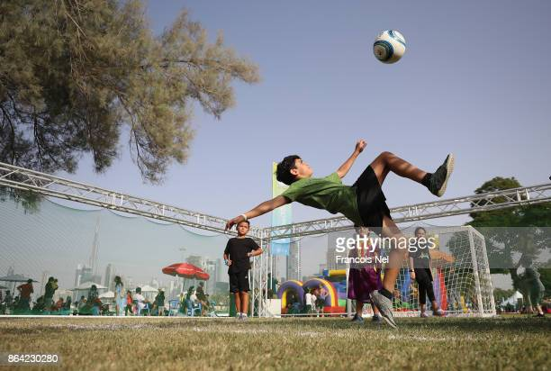 Kids play football during the Dubai Fitness Challenge Opening Carnival at Safa Park on October 20 2017 in Dubai United Arab Emirates The inaugural...