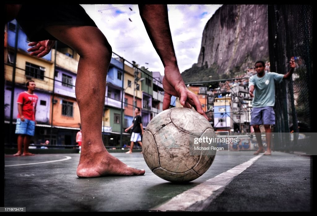 Kids play football in a favela on June 29, 2013 in Rio de Janeiro, Brazil.