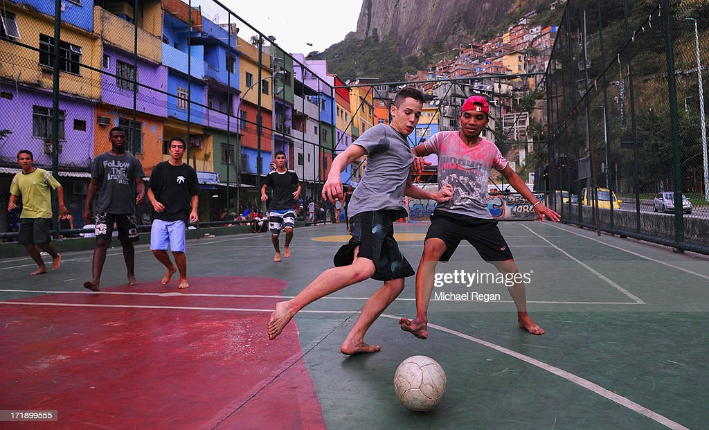 Kids play football in a favela on June 29, 2013 in Rio de Janeiro, Brazil. The final of the FIFA Confederations Cup between Brazil and Spain will take place in the city on June 30.