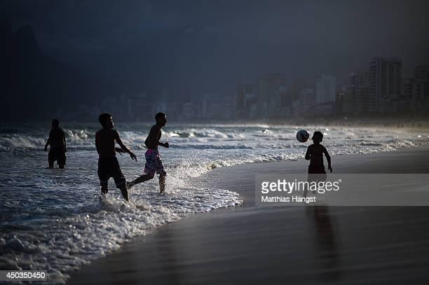 Kids play football on Ipanema beach on June 9 2014 in Rio de Janeiro Brazil