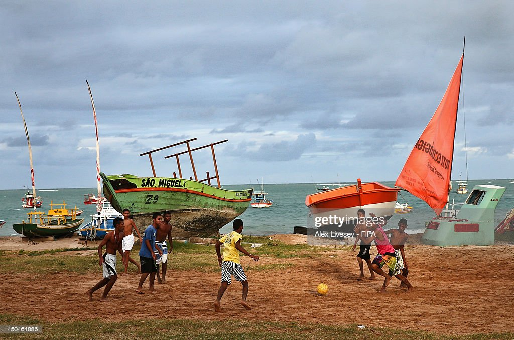 Kids play football on the beach as Brazil prepares for World Cup on June 11, 2014 in Maceio, Brazil.