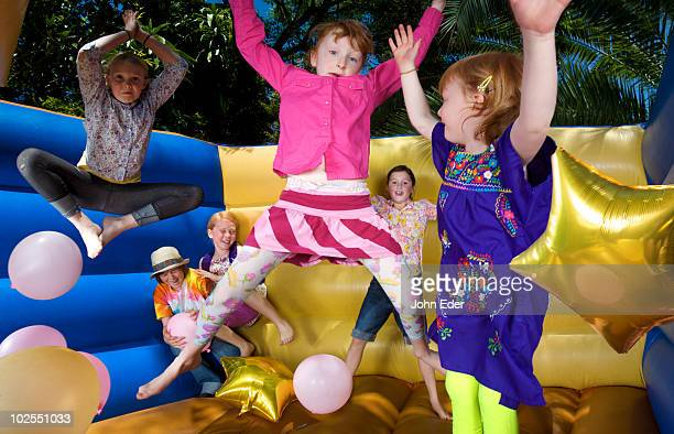 Kids play in moon bounce