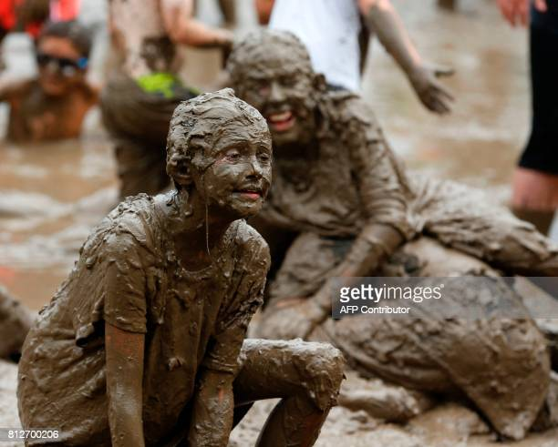 Kids play in the pit at Wayne County's annual Mud Day at Nankin Mills Park on July 11 2017 in Westland Michigan The mud pit contains 200 tons of top...