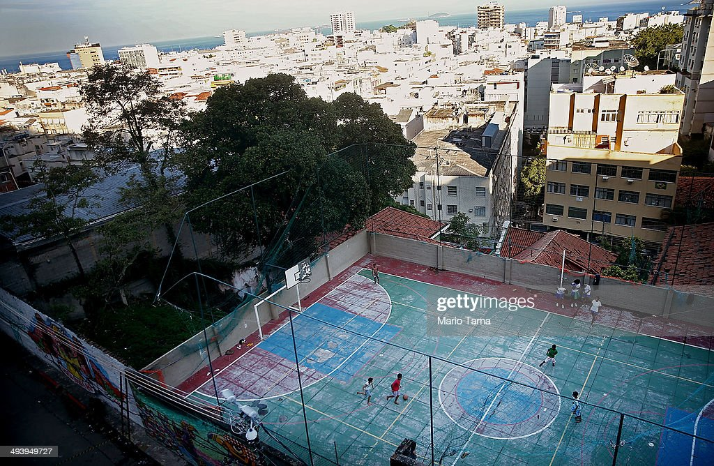Kids play soccer in the pacified Pavao-Pavaozinho community at the start of an investigation into the death of dancer Douglas Rafael da Silva Pereira on May 26, 2014 in Rio de Janeiro, Brazil. Police re-constructed the death of Pereira this afternoon. Protests and shootings broke out following the discovery of Pereira's body in the 'favela' last month. Ahead of the World Cup, some of Rio's pacified favelas have seen an increase in violence, including a number of shootings in Pavao-Pavaozinho. Around 10,000 people live in the Cantagalo and Pavao-Pavaozinho communities with a total of around 1.6 million Rio residents residing in shantytowns, many of which are controlled by drug traffickers.