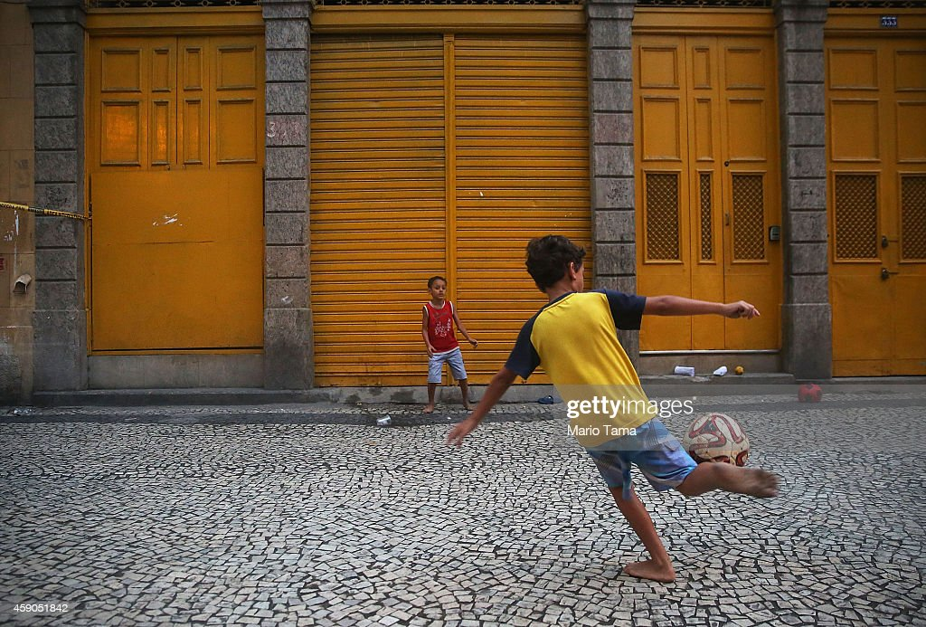 Kids play soccer in the Port District on November 15, 2014 in Rio de Janeiro, Brazil. Today is Republic Day in Brazil, marking the day in 1889 when Emperor Dom Pedro II was removed from power in a military coup and Brazil was declared a Republic.