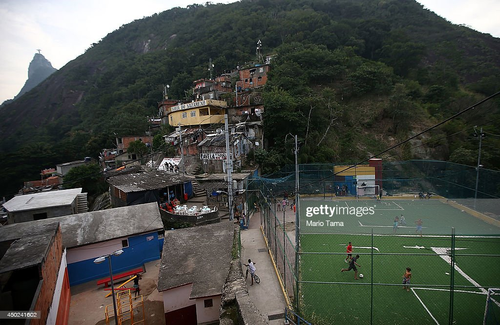 Kids play soccer in the Santa Marta shantytown, or 'favela', on June 7, 2014 in Rio de Janeiro, Brazil. Brazil is in final preparations to host the 2014 FIFA World Cup which kicks off June 12.