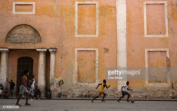 Kids play soccer on the street on May 07 2015 in Havana Cuba In the evening the streets of Havana are filled with children playing all different...