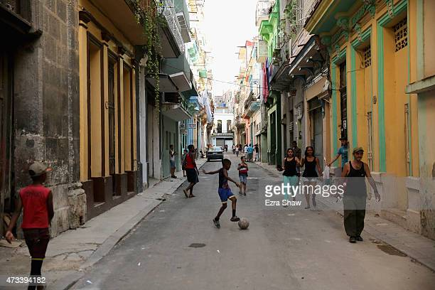 Kids play soccer on the street on May 09 2015 in Havana Cuba In the evening the streets of Havana are filled with children playing all different...