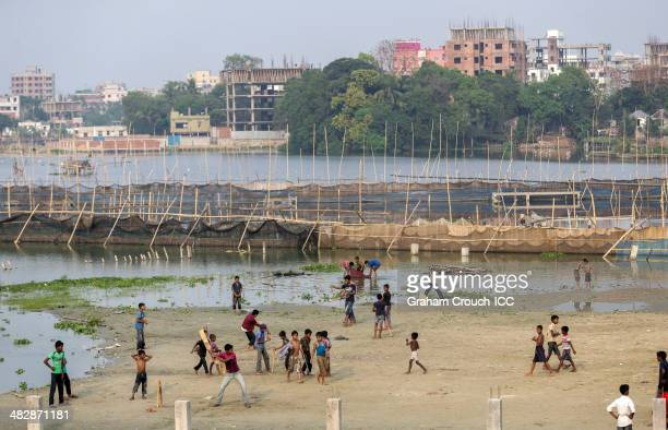 Kids play street cricket alongside fish farms at Mirpur ahead of India and Sri Lanka Final ICC World Twenty20 Bangladesh 2014 during the ICC World...