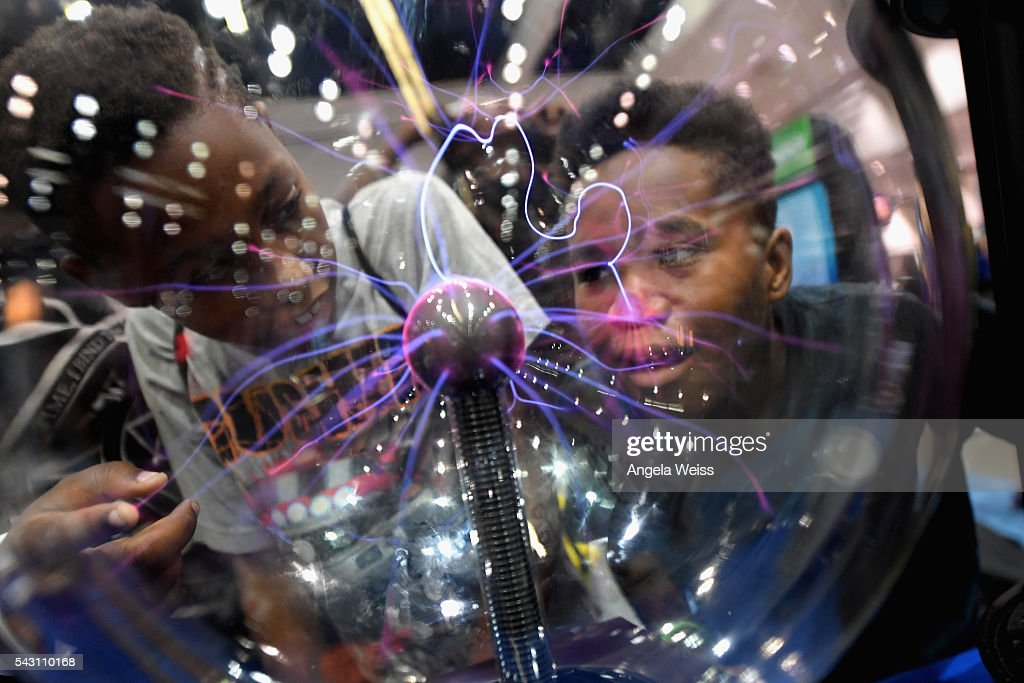 Kids play with a plasma globe at FAN FEST during the 2016 BET Experience on June 25, 2016 in Los Angeles, California.