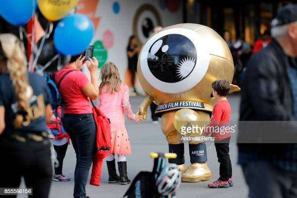 Kids play with the mascot at the opening for kids during the 13th Zurich Film Festival on September 29 2017 in Zurich Switzerland The Zurich Film...