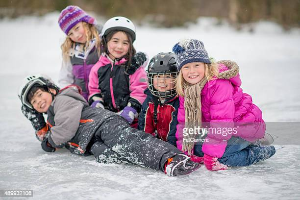 Kids Playing Around While Ice Skating