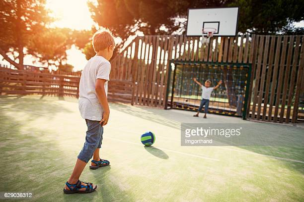 Kids playing football in the schoolyard