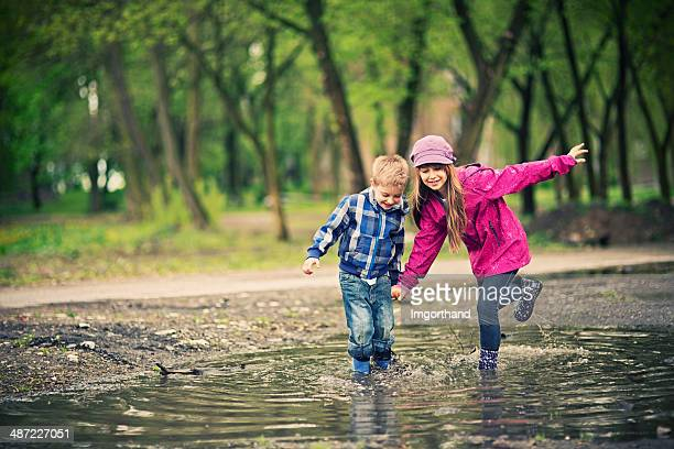 Kids playing in a puddle