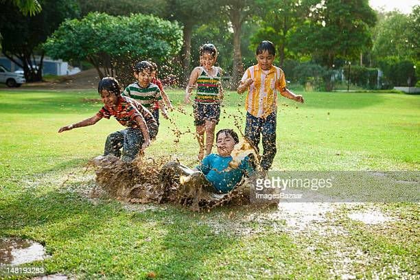 Kids (4-7) playing in puddle of water