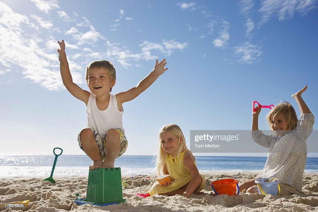 Kids playing on beach : Stock Photo