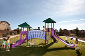 Kids playing on playground slides outdoors