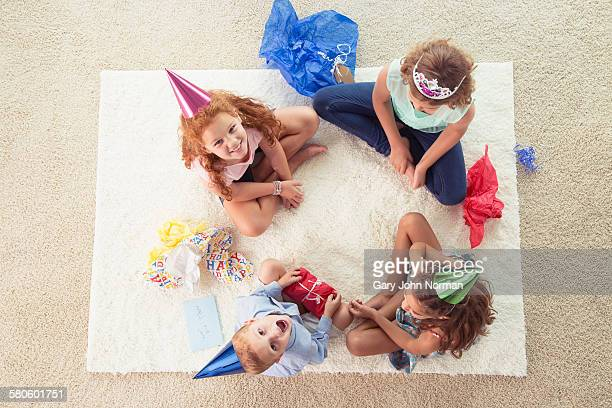 Kids playing Pass the Parcel at a party.