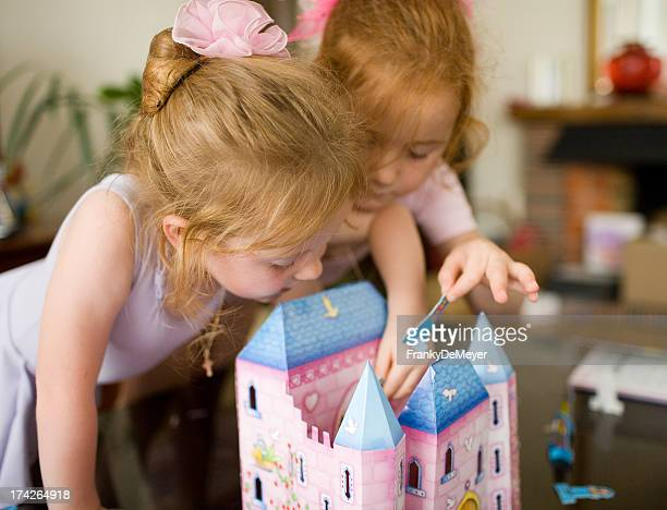 Kids playing together with doll house
