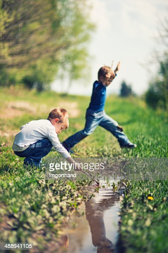 Kids playing with a puddle
